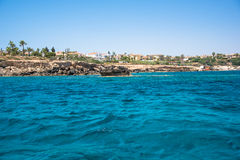 Distant rocky shore. Seen from a sea Stock Images