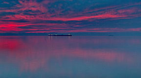 Distant ship. Ship in the sea in a sunset day,in a greek town thessaloniki,in a warm day of january Stock Photo