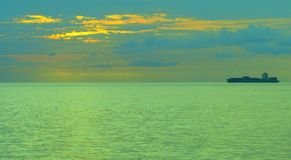 Distant Ship at Sunset Royalty Free Stock Images