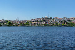 Distant shore of Istanbul with hills and houses. Stock Photos