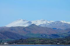 Distant snow covered English Lake District mountains royalty free stock photography