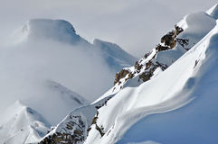 Distant snow covered peaks above clouds Royalty Free Stock Photography