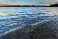 Distant snowy mountain range behind Lake Laberge Royalty Free Stock Image