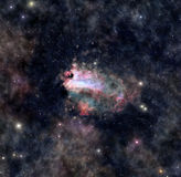 Distant space nebula. Space background with many stars and bright nebula in the center Royalty Free Stock Photo