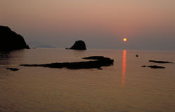 Distant sunset. Sunset in Milos stock photo