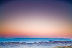 Distant sunset. View towards distant desert mountains after the sunset Stock Photo