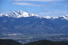 Distant Tall Snow Capped Mountain Stock Photo