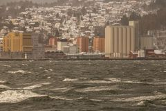Distant Trondheim town and stormy sea stock photography
