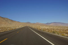 Distant truck  on desert highway Royalty Free Stock Image