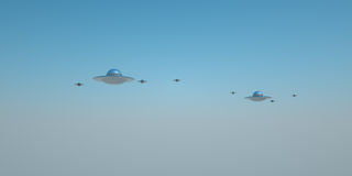 Distant UFOs. A group of UFOs in the distance amongst a blue sky. 3D rendering Stock Photography