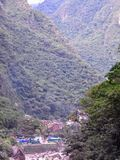 A distant view of Aguas Calientes, a tourist town nestled in the. Andes at the base of Machu Picchu stock photography