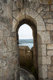 Distant view through arch Stock Photo