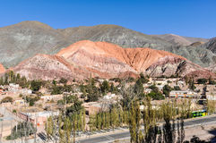 Distant view of Cerro de los Siete Colores, Purnamarca, Argentin Stock Photos