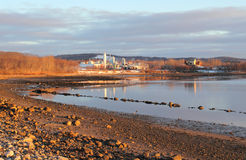 Distant view of chemical factory. A distant view of a chemical factory in the early morning light on the coast of Maine Royalty Free Stock Photo