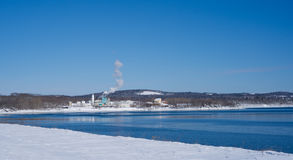 Distant view of a chemical plant in the winter Stock Photos