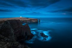 Distant view on Duncasby Head Lighthouse, northern coast of scot stock image