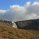 Distant view of the Dynjandi, famous waterfall in the westfjords. Dynjandi, also named Fjallfoss. Famous waterfall in Iceland Stock Photos