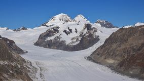 Distant view of the Jungfraujoch. Aletsch glacier. Eiger and Mon. View from mount Eggishorn. Aletsch glacier. Mountains Jungfrau, Monch and Eiger stock photography
