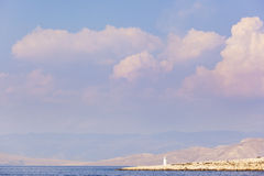 Distant view on lighthouse and mountains in Croatia Stock Photos