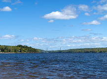 Distant view of the Penobscot Narrows Bridge. A distant view of the Penobscot Narrows Bridge over the river from Sandy Beach in Stockton Springs, Maine Royalty Free Stock Images