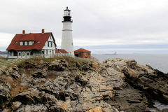 Distant view of Portland Head lighthouse, with stormy skies and rough seas, Maine,2016. Beautiful architecture in distant view of much beloved Portland Head stock photos