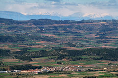 Distant view of pyrenees and windmills Stock Photo