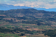 Distant view of pyrenees and windmills Stock Image