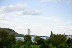 Distant view on the rhine and the landscape under a blue sky in bingen am rhein in hessen germany stock images