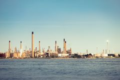 Distant view of a shoreline refinery stock photography