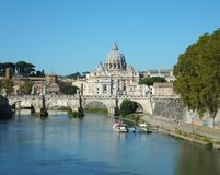 Distant view of St. Peter's Basilica and Ponte Sant'Angelo over the Tiber in Rome taken from Ponte Umberto stock photography