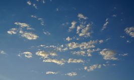 Stratocumulus clouds on blue sky. Distant view of stratocumulus clouds on blue sky royalty free stock photography