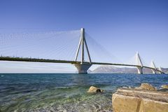 Panoramic view of suspension bridge Rio - Antirio near Patra, Greece. Distant view of suspension bridge Rio - Antirio near Patra, Greece royalty free stock images