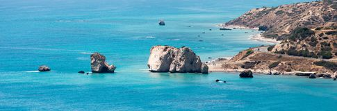 A distant view to Aphrodite Rock tourist attraction in Cyprus coast Stock Images