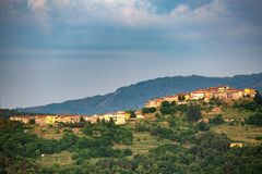 Distant view of a village. In the rural countryside of Tuscany, Italy stock images