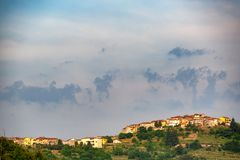 Distant view of a village. In the rural countryside of Tuscany, Italy stock photo