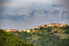 Distant view of a village. In the rural countryside of Tuscany, Italy stock photos