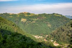 Distant view of a village. In the rural countryside of Tuscany, Italy stock image