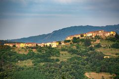 Distant view of a village. In the rural countryside of Tuscany, Italy royalty free stock images