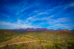 A distant view of Wilpena Pound. A gravel road winds through the landscape to Wilpena Pound Stock Photography