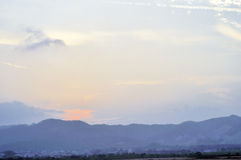The distant village sunset Stock Photos