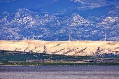 Distant wind turbine on the island Stock Photos