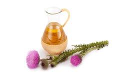 Distelolie en de bloem van de melkdistel Stock Afbeelding