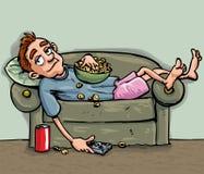 Distensione teenager del fumetto sul sofà Fotografie Stock Libere da Diritti