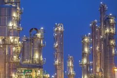 Distillation towers detail. Chemical industry distillation towers detail at night. Petrochemical background Royalty Free Stock Image