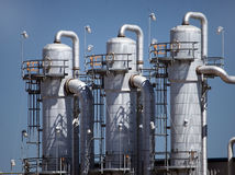 Distillation Towers of Ethanol Plant. Close-up of three metal distillation towers at ethanol plant facility Stock Images