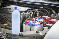 Distilled water for car battery Royalty Free Stock Photos