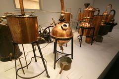 Distiller for the production of perfume water, the copper metal vat stock photography