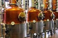 Distillery - copper. Industrial Distillery - coppers in a row stock photo