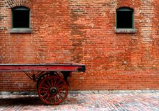 Distillery district toronto. Old red wooden cart at the distillery district in toronto canada royalty free stock photography