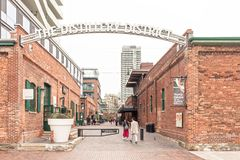The Distillery District in Toronto, Canada. Toronto, Canada - Oct 13, 2017: Entrance to the historic Distillery District in the city of Toronto. Province of stock photos